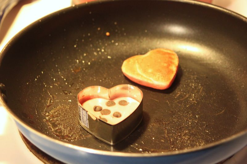 Pink heart-shaped chocolate chip pancakes